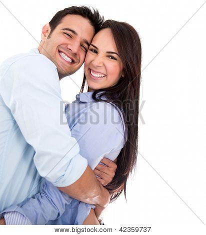 Hermosa cariñosa pareja sonriendo - aislado sobre un fondo blanco