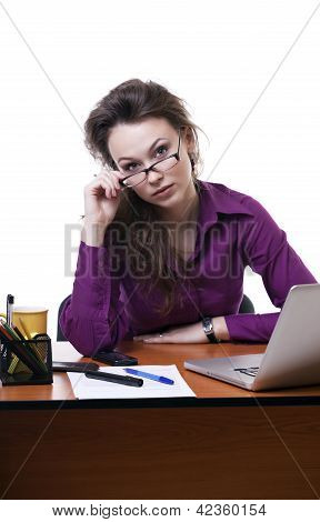Businesswoman Looking Throu Her Glases At A Table Isolated On White
