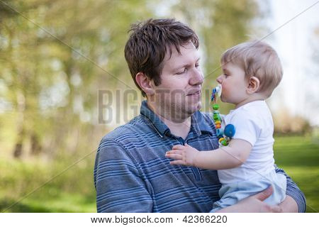 Young Father And Sweet Baby Boy In Spring Forest