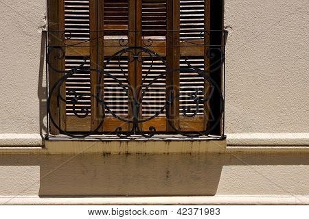Old Window Grate And Shadow