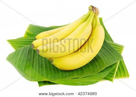 Bunch of fresh bananas on banana leaves