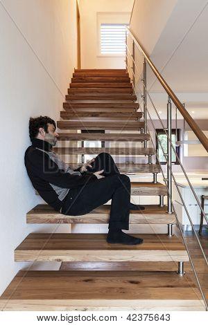 modern loft, man sitting on the stairs