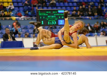 KIEV, UKRAINE - FEBRUARY 16: Match between Huchok, Belarus, red and Fomenko, Russia during XIX International freestyle wrestling and female wrestling tournament in Kiev, Ukraine on February 16, 2013