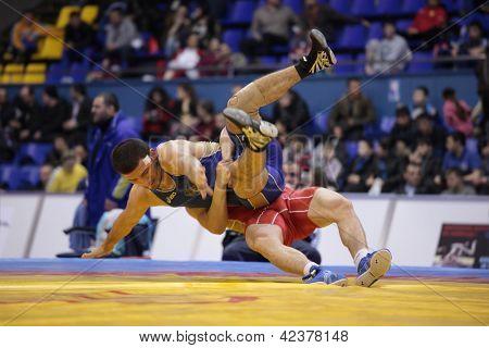 KIEV, UKRAINE - FEBRUARY 16: Match between Chakayev, Russia, red and Mashadov, Russia during XIX International freestyle wrestling and female wrestling tournament in Kiev, Ukraine on February 16, 2013