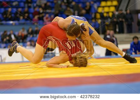 KIEV, UKRAINE - FEBRUARY 16: Match between Huchok, Belarus, red and Fomenko, Russia during XIX International freestyle wrestling and woman wrestling tournament in Kiev, Ukraine on February 16, 2013