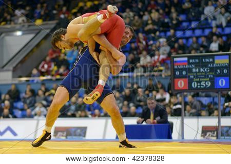 KIEV, UKRAINE - FEBRUARY 16: Match between Rabadanov, Russia, red and Aldatov, Ukraine during International freestyle wrestling and female wrestling tournament in Kiev, Ukraine on February 16, 2013