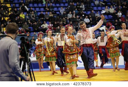 KIEV, UKRAINE - FEBRUARY 16: Folklore dance group Perlyna on opening ceremony of XIX International freestyle wrestling and female wrestling tournament in Kiev, Ukraine on February 16, 2013