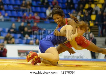 KIEV, UKRAINE - FEBRUARY 16: Match between Anthony, USA, red and Pulkovska, Ukraine during XIX International freestyle wrestling and female wrestling tournament in Kiev, Ukraine on February 16, 2013