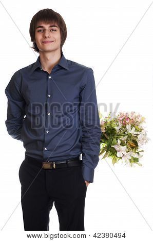 Happy men hide bouquet of flowers on his back.  isolated on whit