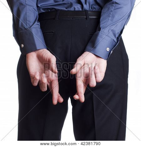 Man hold and hide on his back his cross fingers