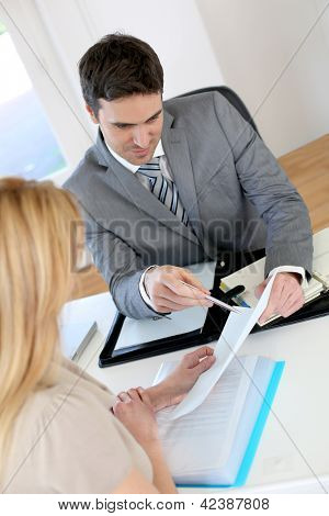 Woman meeting banker to set up her own business
