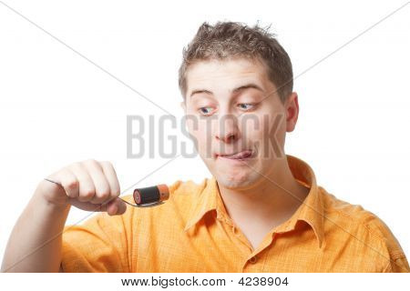 Man Trying To Eat Battery