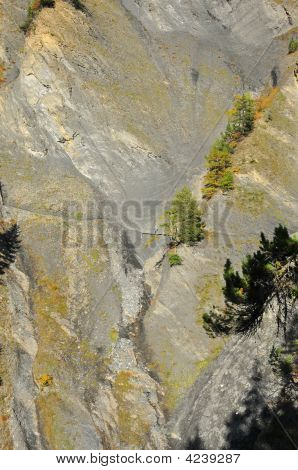 Man Standing On Ancient Aqueduct Crossing Cliff Face