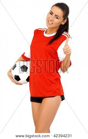 Beautiful female soccer player holding ball, wearing red shirt
