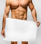 foto of incognito  - Naked muscular man covering with a banner   - JPG