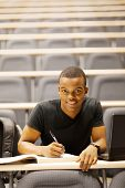 picture of hall  - male african american college student in lecture hall - JPG
