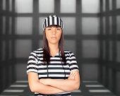 Attractive brunette prisoner behind bars pending judgment
