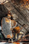 stock photo of festering  - Iron made rusty lead screw of and old timber ship - JPG