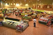 stock photo of supermarket  - Produce Section of a Large Food Supermarket - JPG