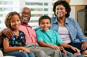 picture of 70-year-old  - Portrait Of Grandparents With Grandchildren - JPG