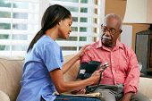foto of visitation  - Nurse Visiting Senior Male Patient At Home - JPG