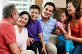 stock photo of multi-generation  - Multi Generation Family Relaxing At Home Together - JPG