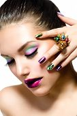Fashion Beauty . Manicure and Make-up. Nail Art. Beautiful Woman With Colorful Nails and Luxury Make