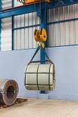 foto of coiled  - Lifting steel coil by overhead crane - JPG