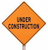 An orange diamond-shaped road sign cautions people that an area under construction lies ahead