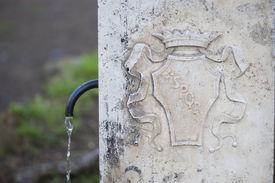 foto of spqr  - Typical public water fountain in Rome - JPG