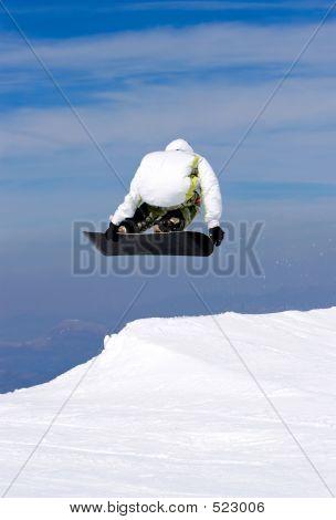 Man Snowboarding On Slopes Of Prodollano Ski Resort In Spain