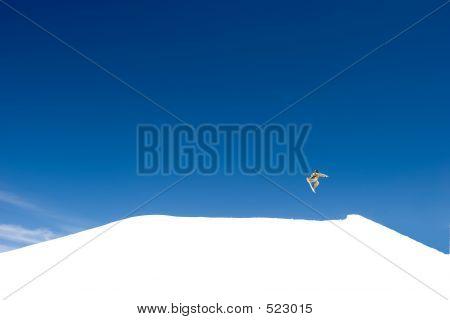 Huge Snowboarding Jump On Slopes Of Ski Resort In Spain