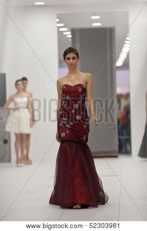 ZAGREB, CROATIA - OCTOBER 12: Fashion model wears evening dress at 'Wedding expo' fashion show, on OCTOBER 12, 2013 in Zagreb, Croatia.
