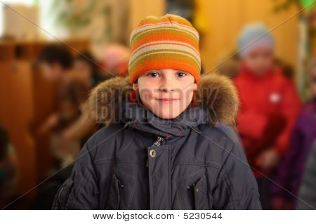Dressed Boy In A Room