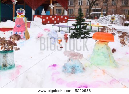 Children's Playground In Court Yard In Winter