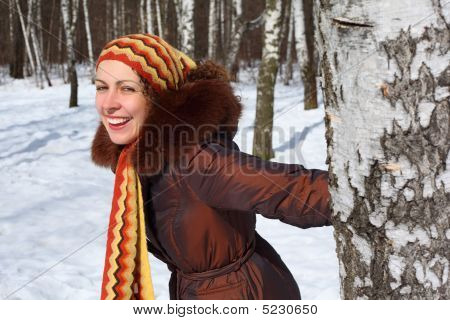 Young Beautiful Woman In Wood Keeps For  Birch In Winter