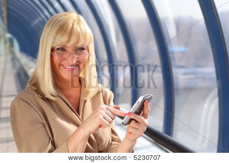 Smiling Middleaged Woman In Glasses With On Pda