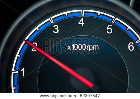 Close up on a tachometer of auto