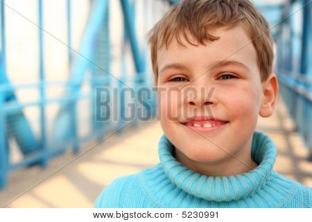 Smiling Boy On Bridge