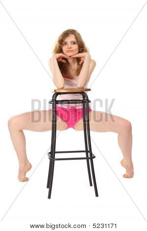 Girl In Sportswear Leans Against Bar Stool