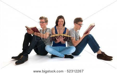 Identically adult male twins with girl reading books in studio