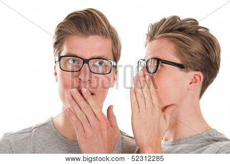 Identically adult male twins whispering in ear isolated over white background