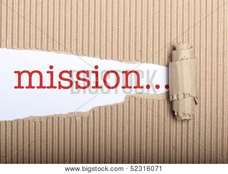Mission Text On Paper And Torn Cardbox