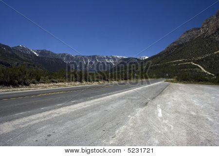 Empty Freeway With The Mountains On A Horizon