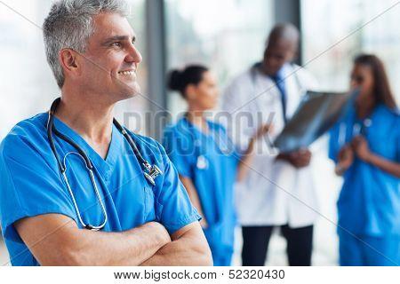 portrait of confident senior medical doctor in hospital