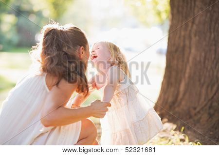 Happy Mother And Baby Having Fun In Park