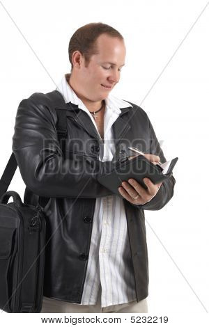 Businessman Holding A Diary