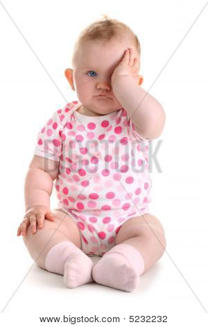 Little Baby Girl Covers Her Eye With Left Hand Isolated On White Plus Shadow