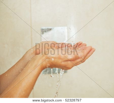Closeup On Woman Hand Catching Water Drops In Shower