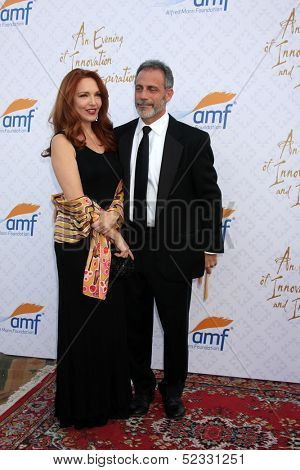 LOS ANGELES - OCT 13:  Amy Yasbeck, Michael Plonsker at the 10th Alfred Mann Foundation Gala at Robinson-May Lot on October 13, 2013 in Beverly Hills, CA